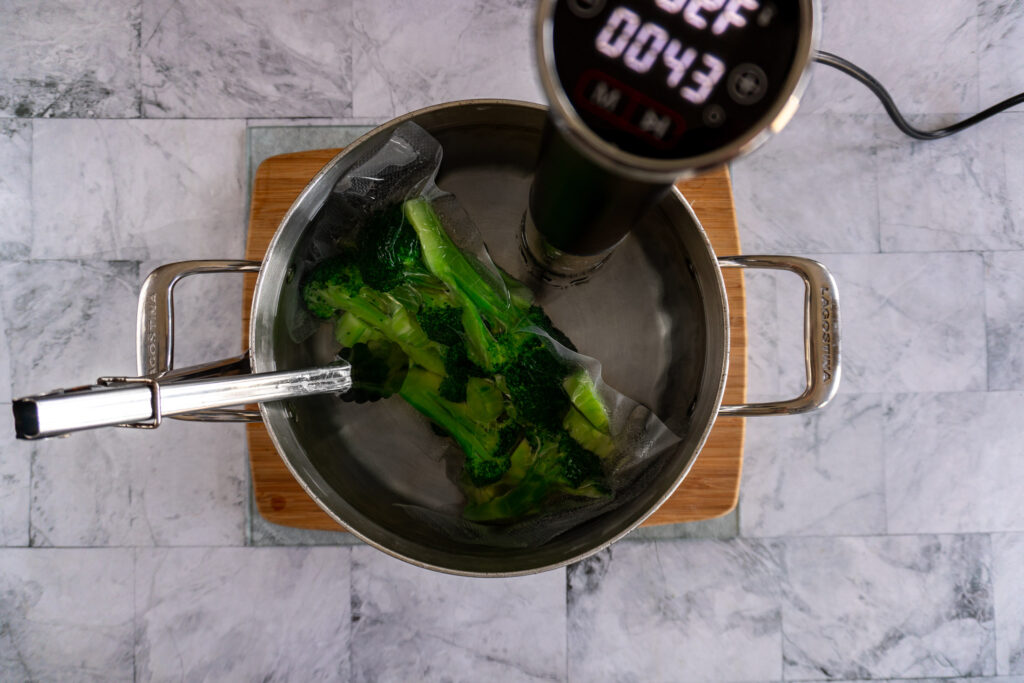 Broccoli in the sous vide water bath.
