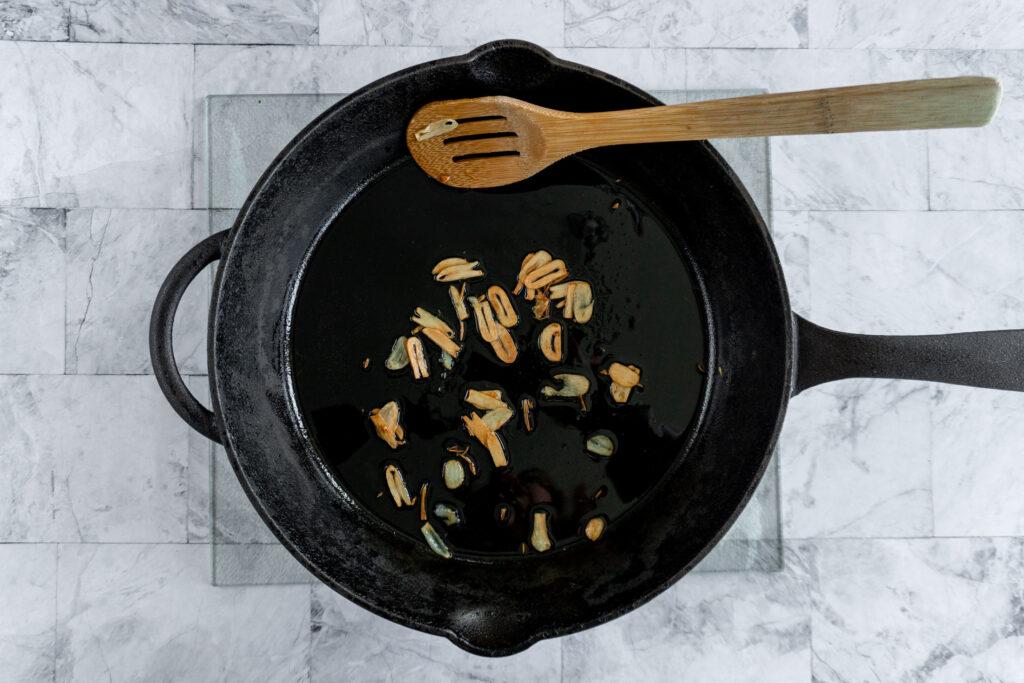 Browned garlic in the skillet.