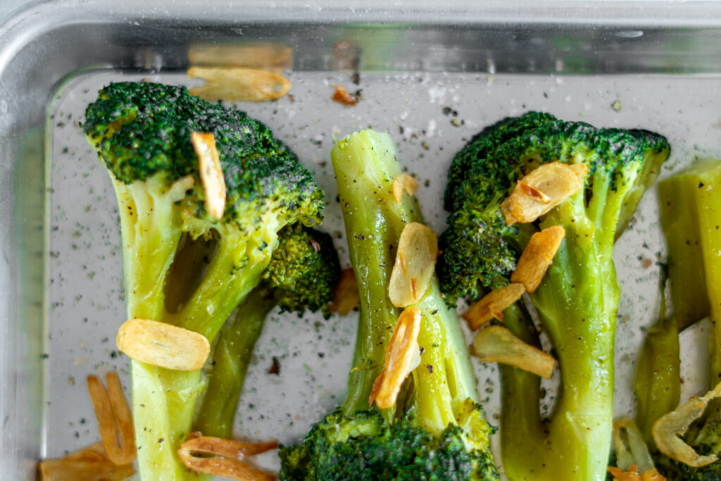 Cooked broccoli in a serving dish.