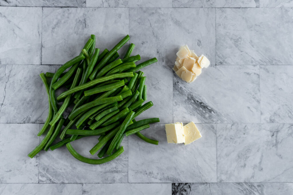Ingredients for the sous vide green beans displayed on a table.