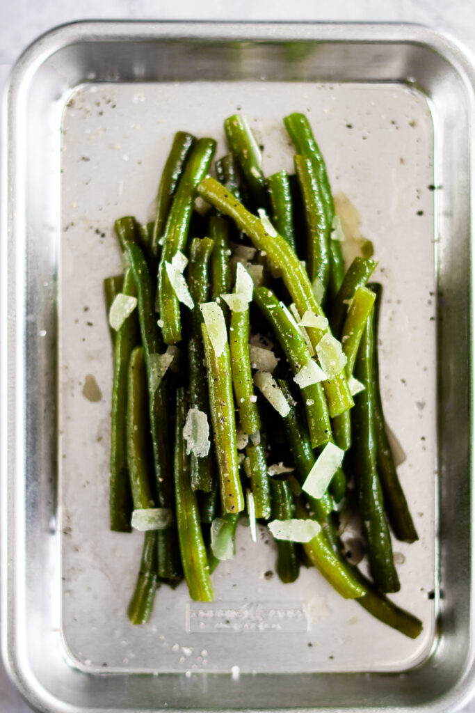 Sous vide green beans in a small baking sheet.