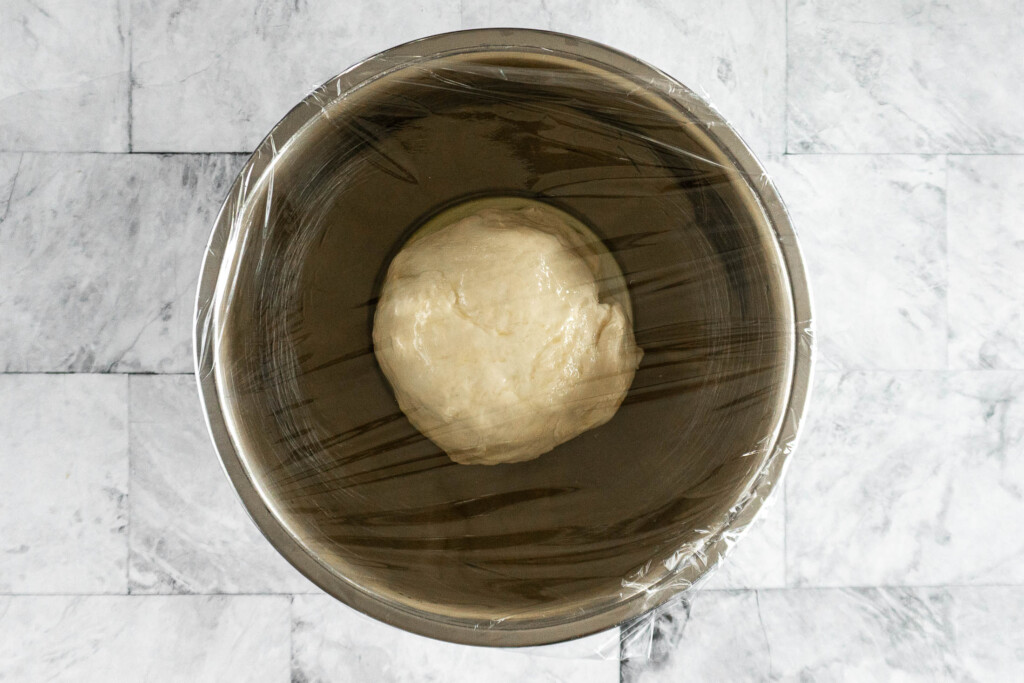 Dough ball in a greased bowl.