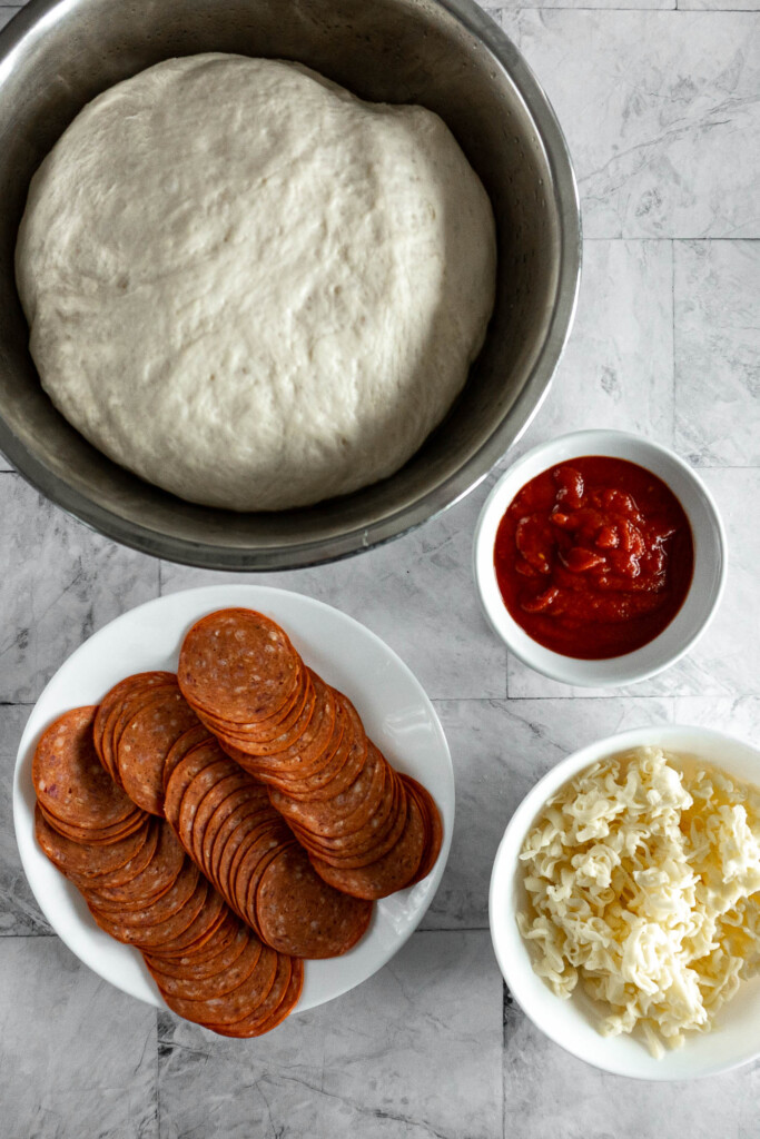 Ingredients for air fryer pizza rolls.
