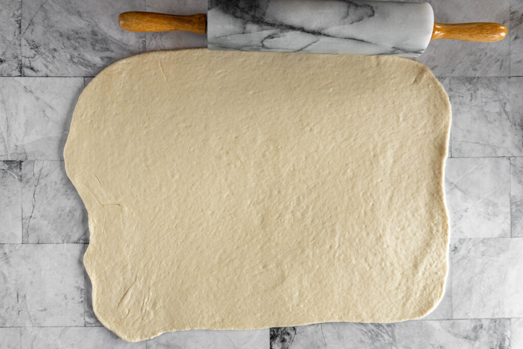 Fully rolled pizza dough.