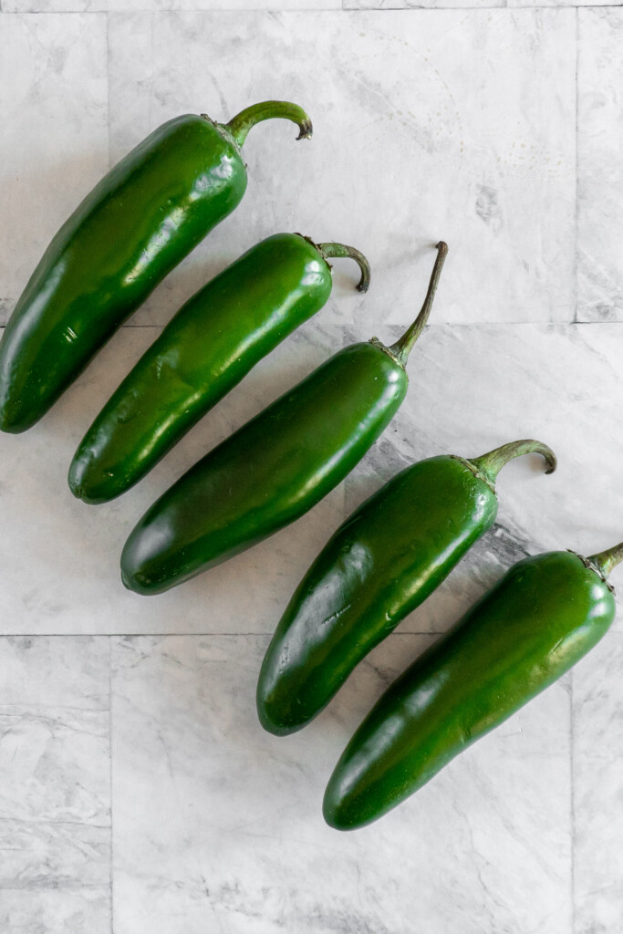 5 ripe jalapenos in a row.