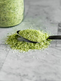 A spoon full of green tinged jalapeno salt.