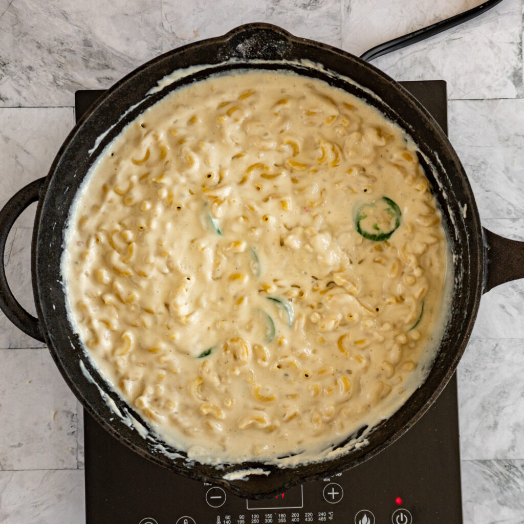 Mixed mac and cheese in a skillet.