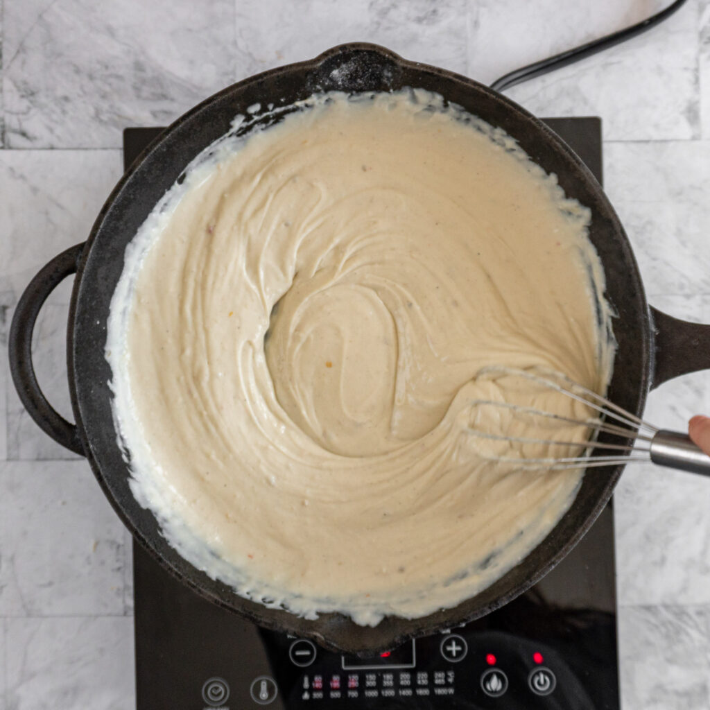 Showing a smooth cheese sauce.