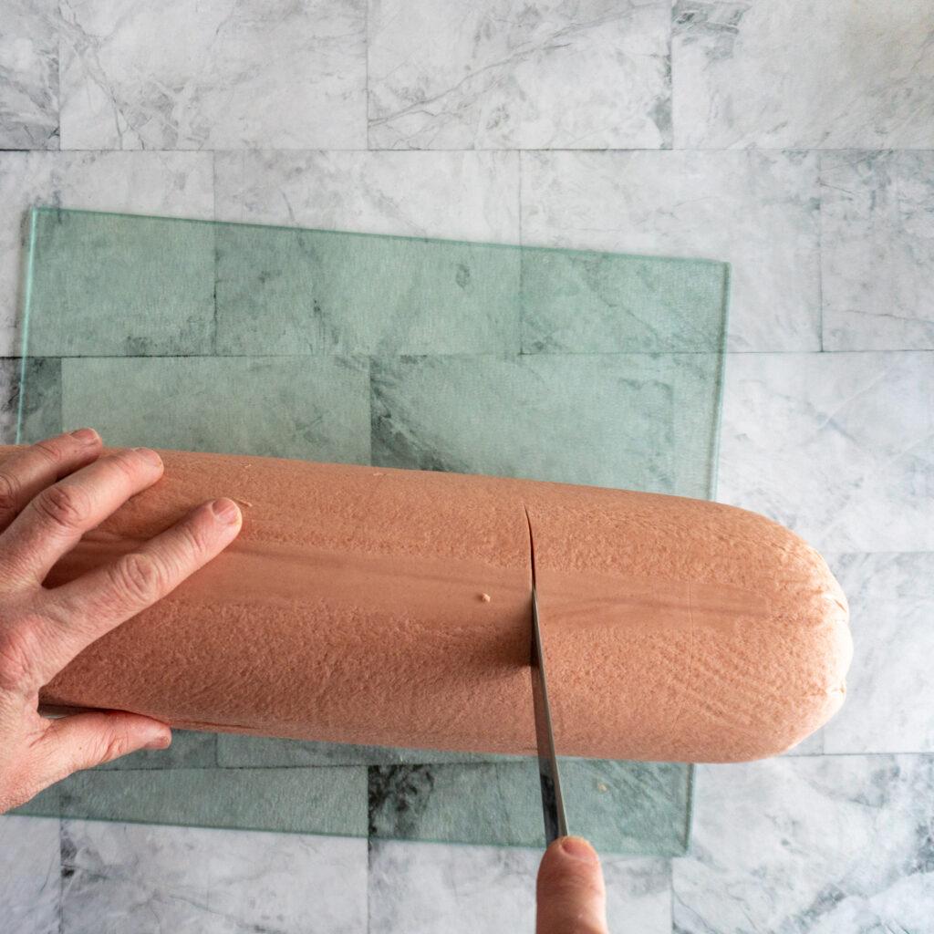 Scoring bologna chub horizontally.