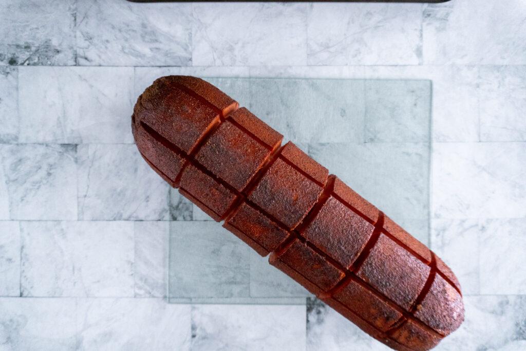 Baloney after smoking on a glass cutting board.