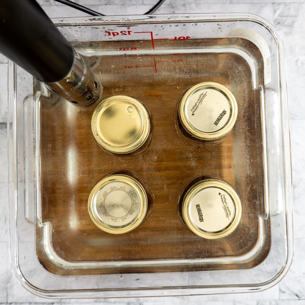 Prepared jars in a sous vide water bath.