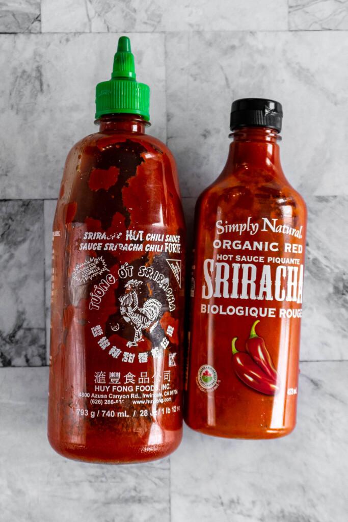 Two bottles of sriracha.
