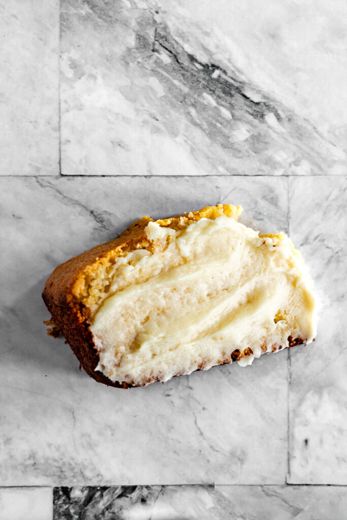 A slice of cornbread slathered with homemade honey butter.