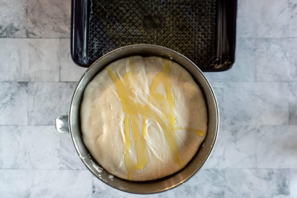 Drizzled focaccia dough with olive oil.