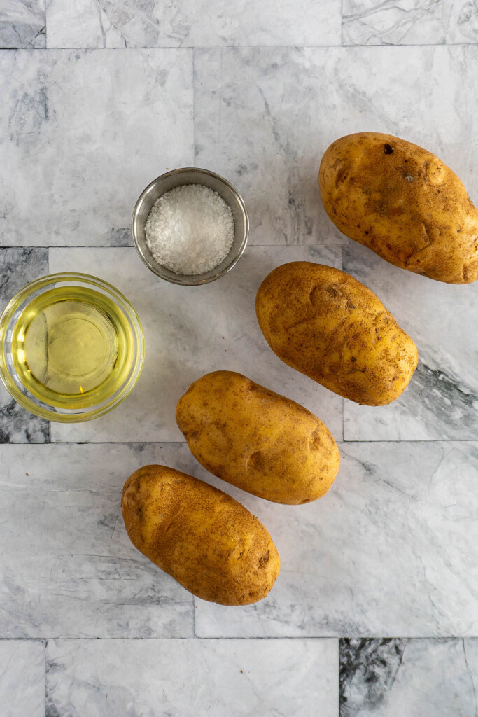 Ingredients for air fryer baked potatoes.