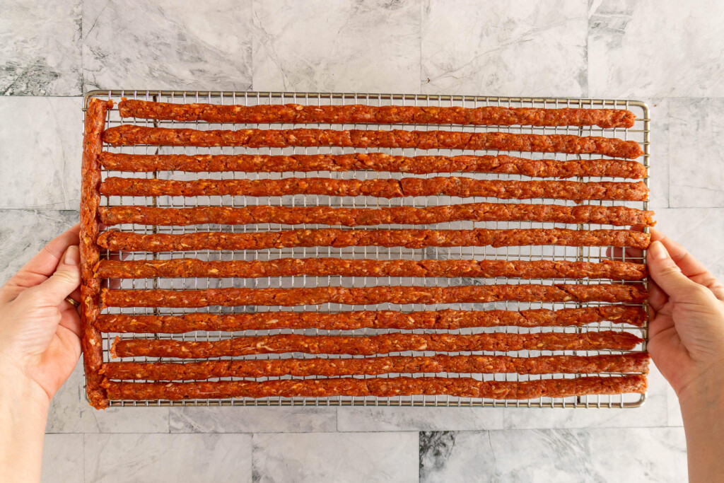 Beef jerky sticks before cooking.