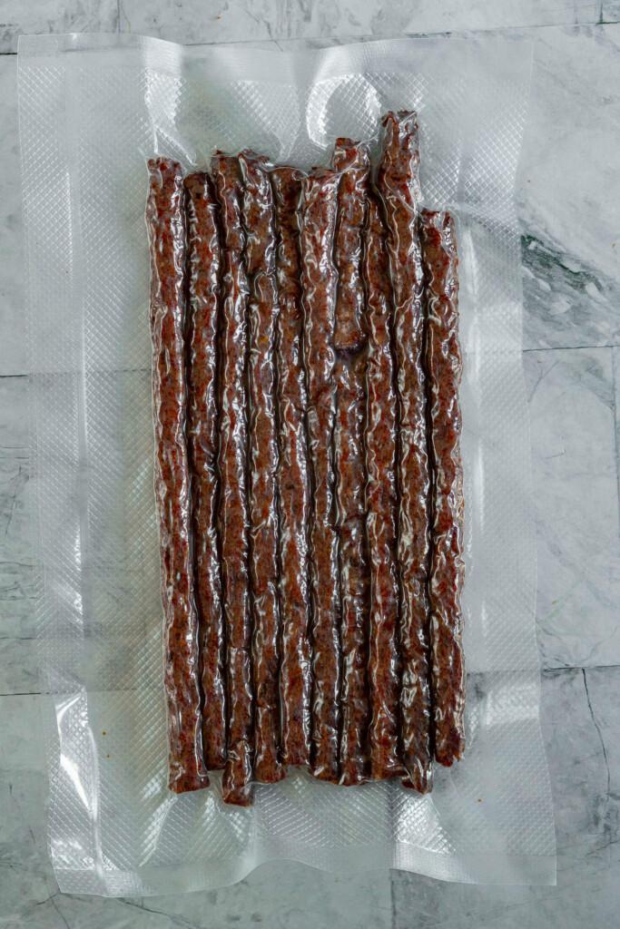 Vacuum sealed beef jerky sticks.