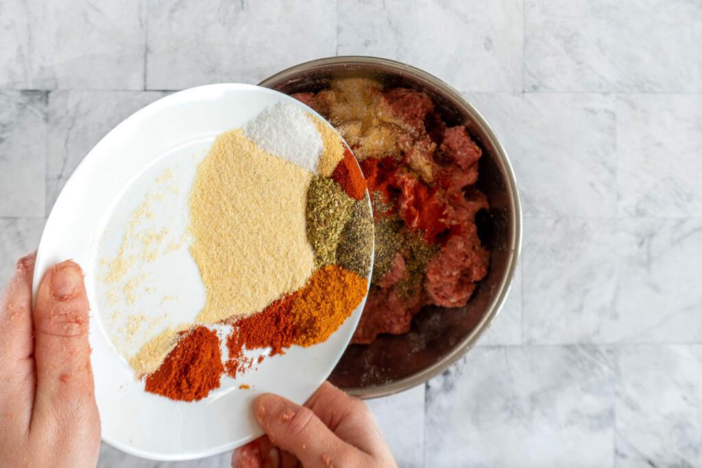Adding spices.