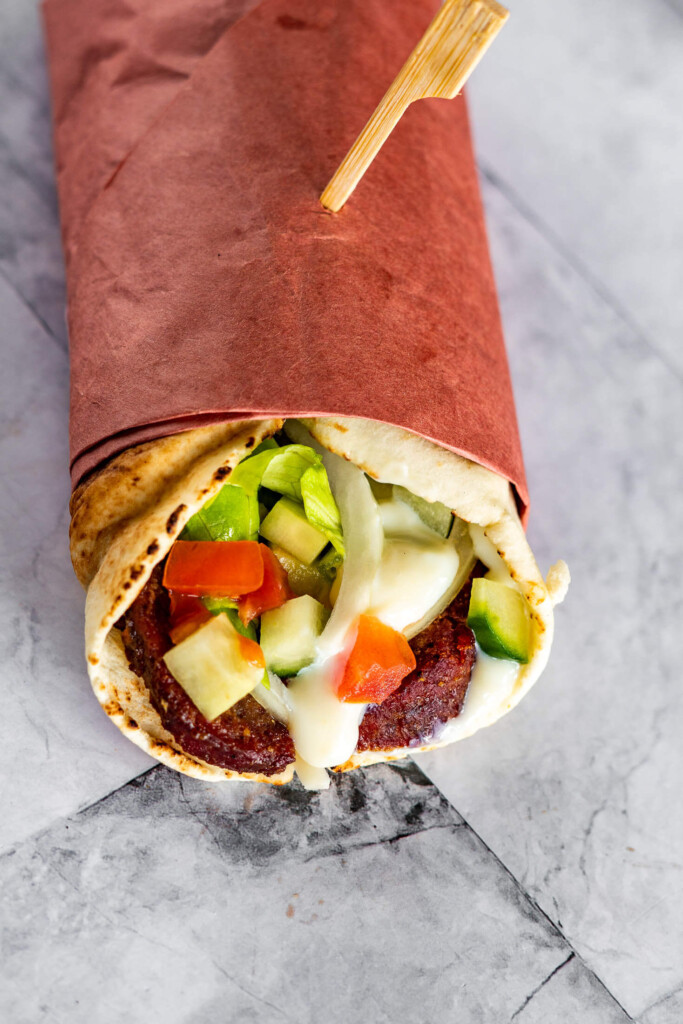 Overhead view of the wrapped pita filled with donair.