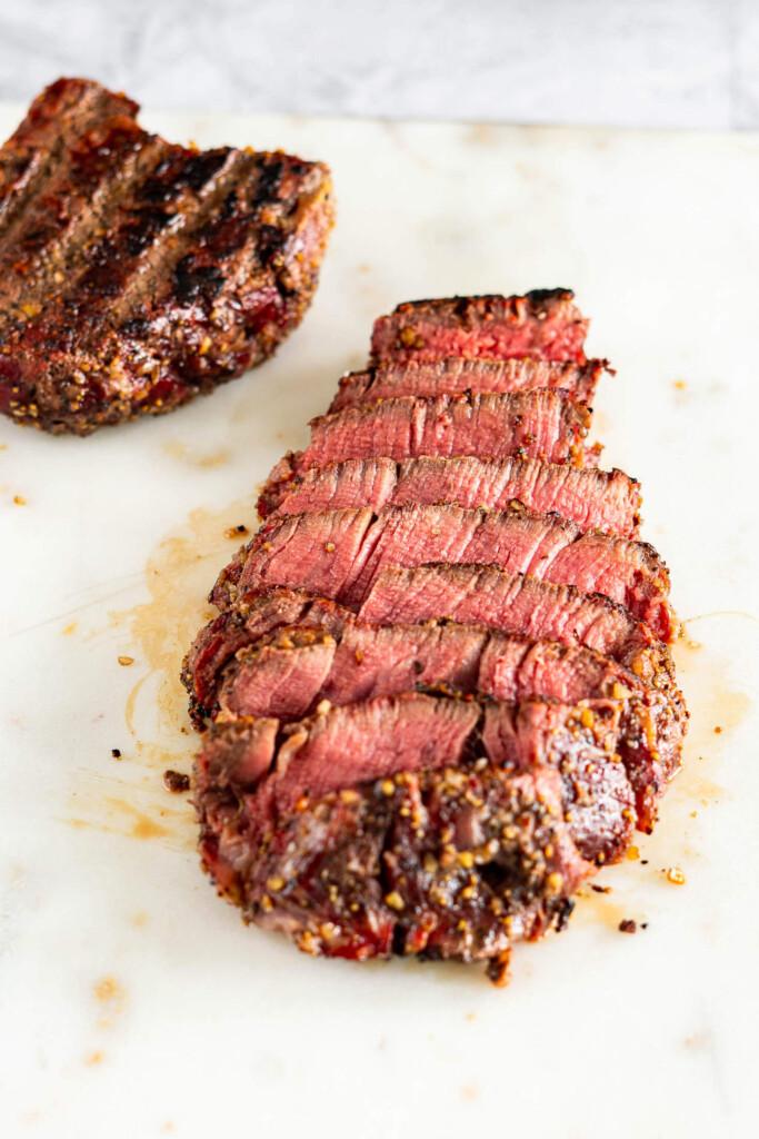 Sliced medium rare smoked filet mignon.