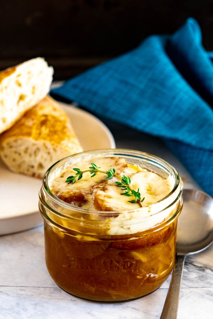 Smoked french onion soup in a mason jar.