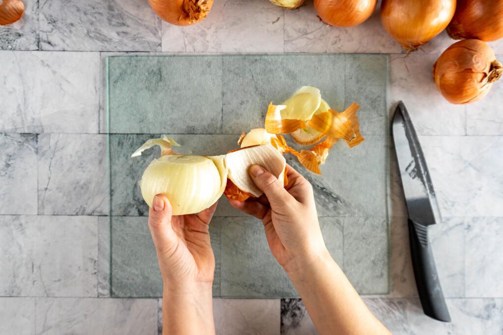 Peeling back the skin on the onion.
