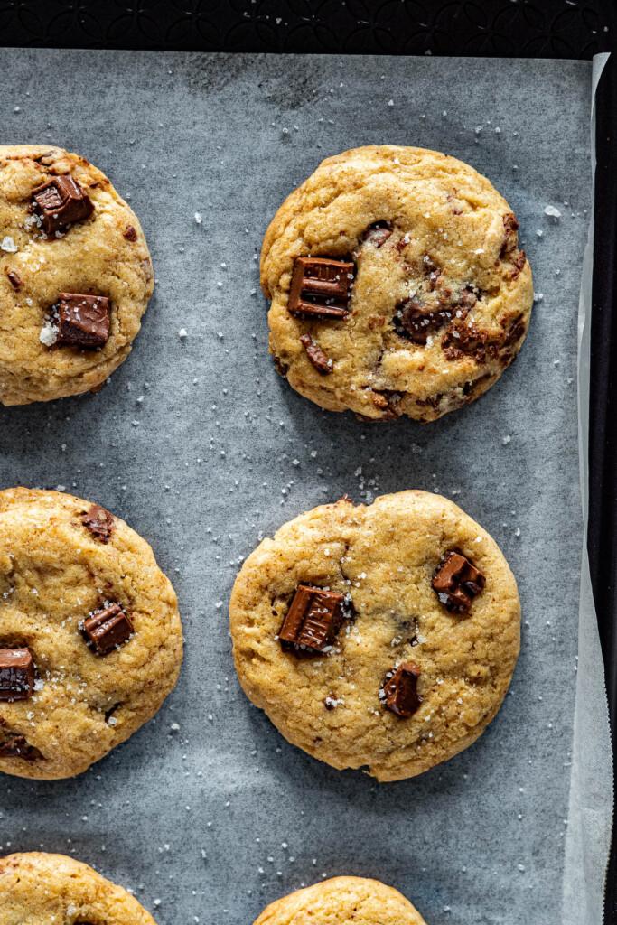 Chocolate chip sourdough cookies on a baking sheet.