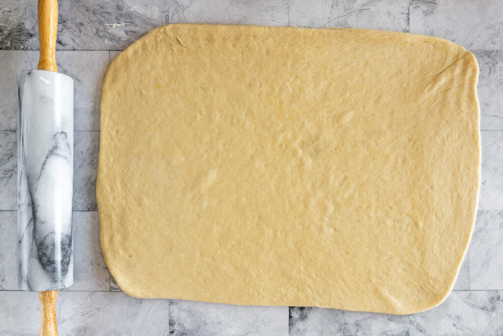 Dough rolled into a large rectangle.