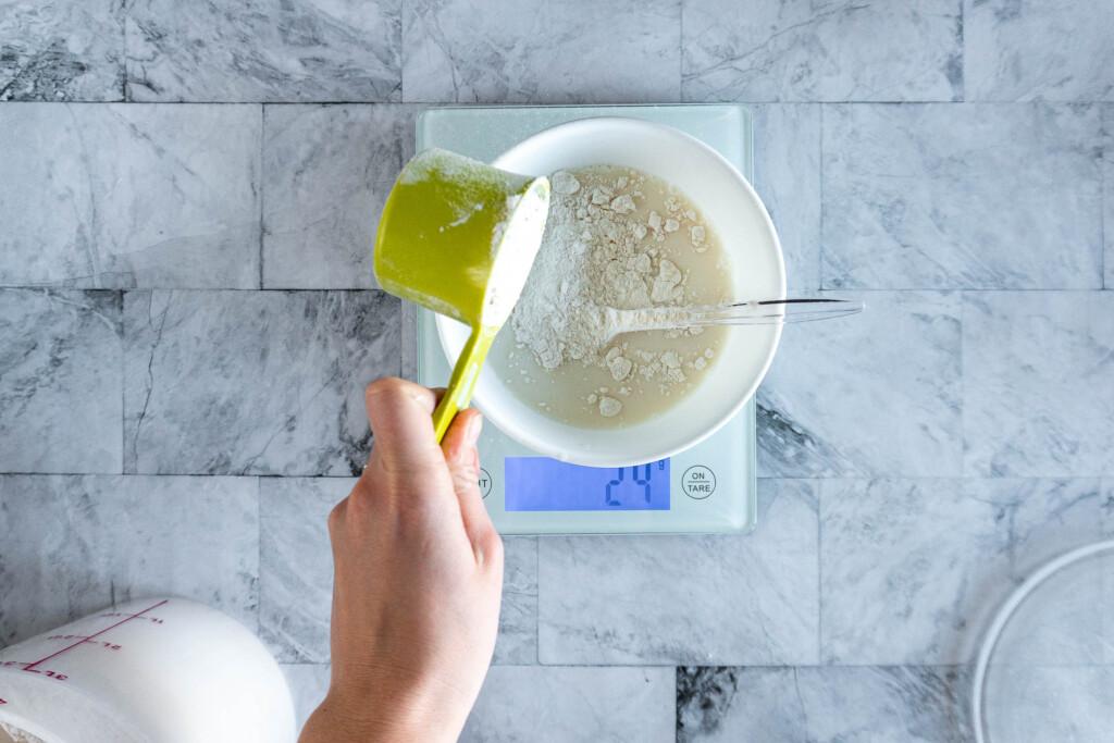 Adding flour to the starter,