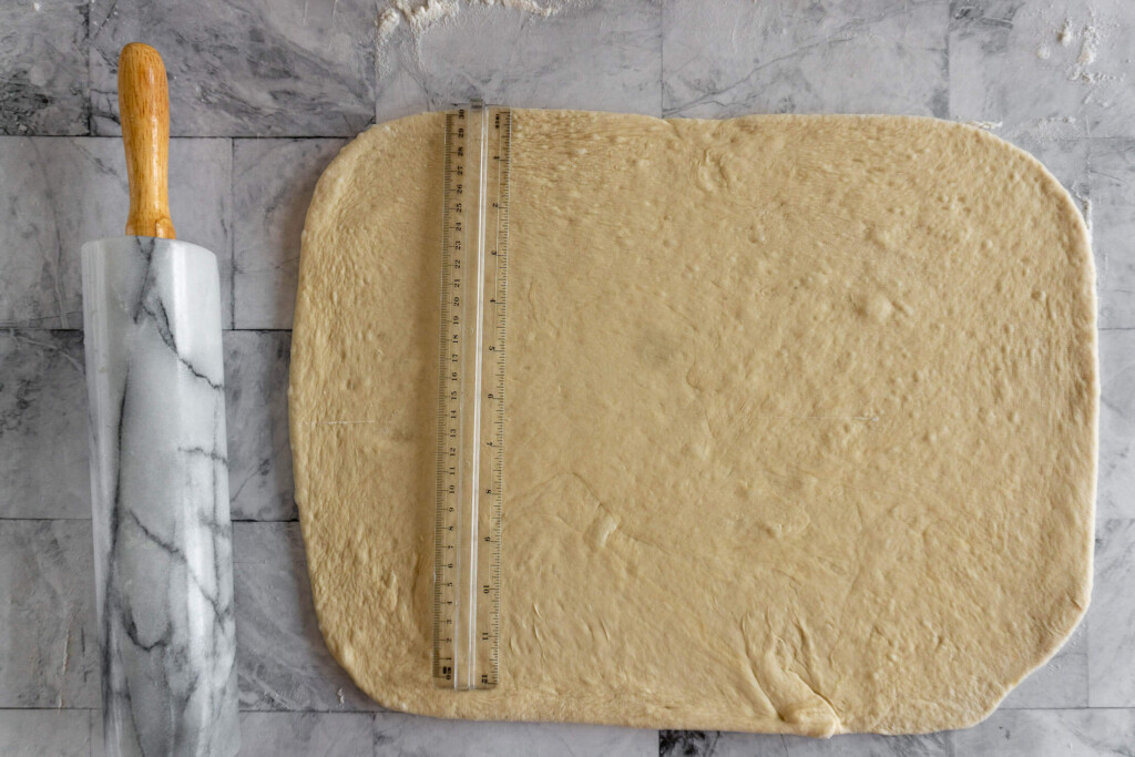 Measuring the dough for size.