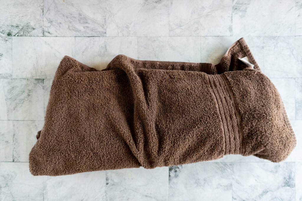 The paper wrapped rib rack is wrapped in a towel for resting.