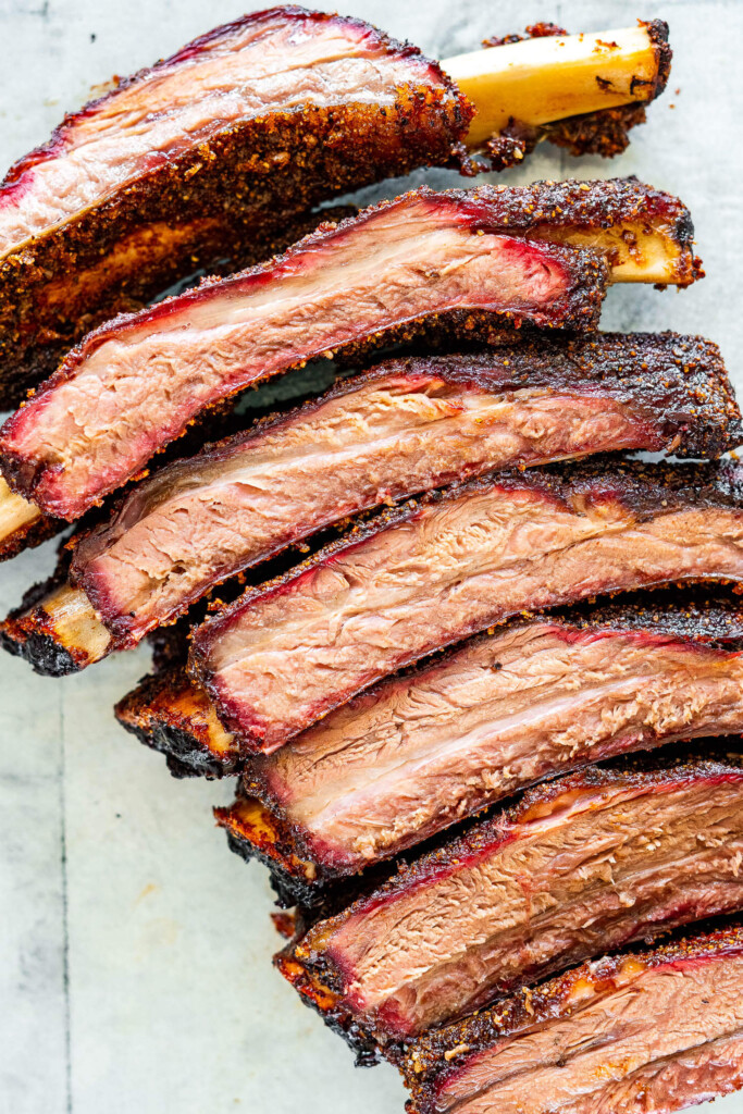 A row of sliced smoked beef back ribs.