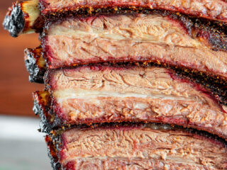 Smoked beef back ribs, sliced and stacked.