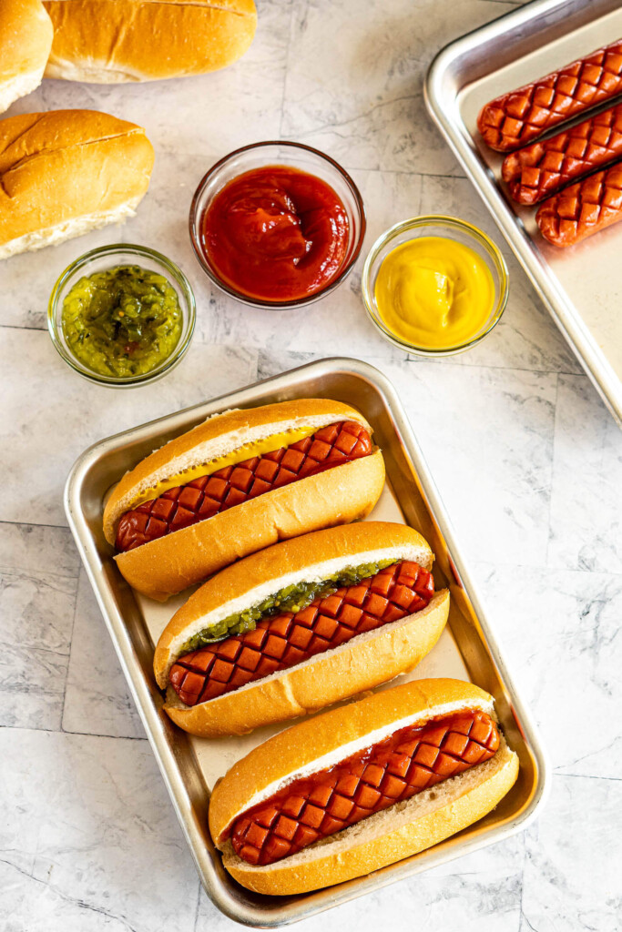 Smoked hot dogs in buns.