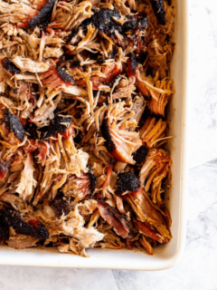 Smoked Pulled Pork in a white dish.
