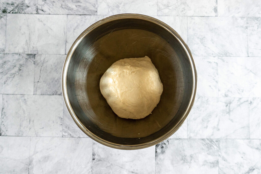 Prepared dough in a bowl for rising.