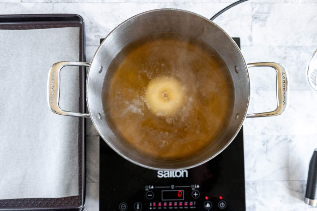 Boiling a formed bagel.