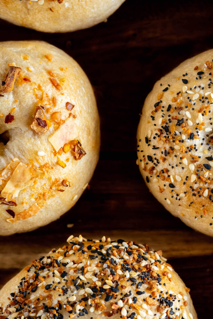 Overhead view of 4 sourdough bagels with everything bagel seasoning.