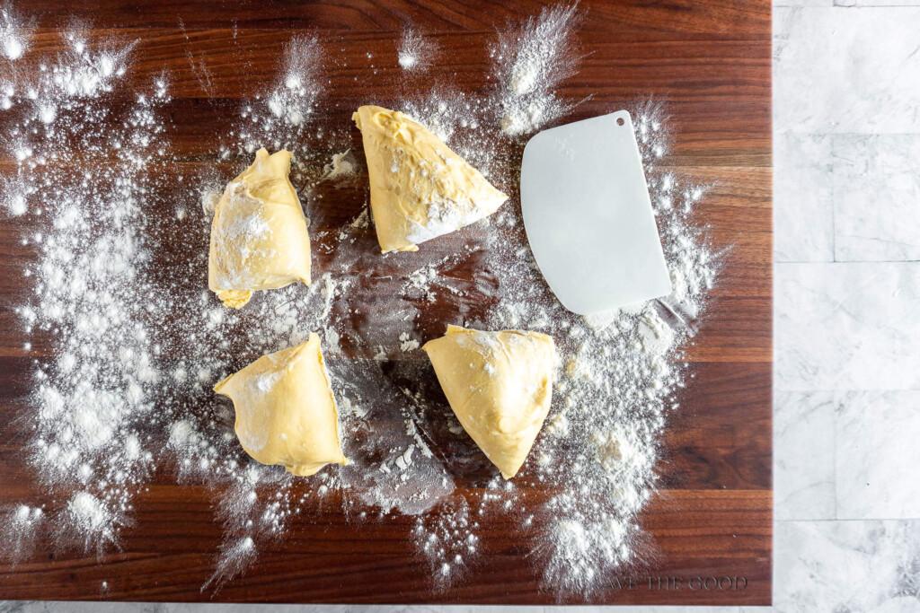 Sourdough pasta dough portioned into 4 pieces.