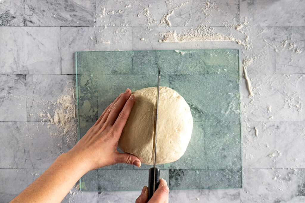 Slicing the dough in half.