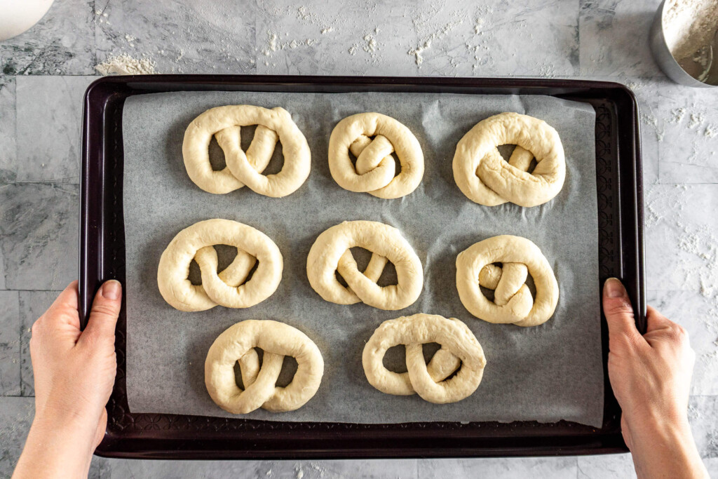 Pretzels on a prepared baking sheet.