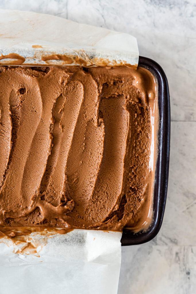 Swirled chocolate ice cream in a dish.