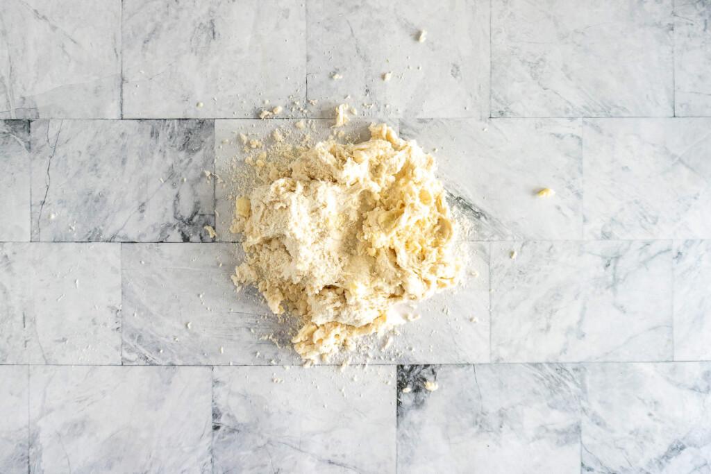 Dough turned onto floured surface.