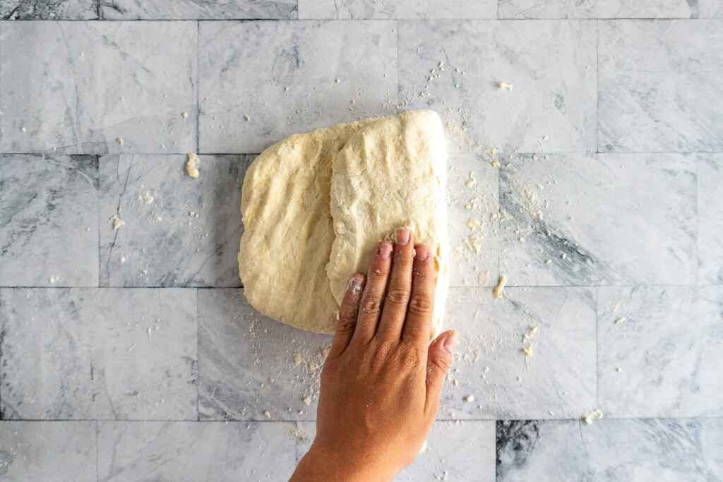 Folding the biscuit dough into thirds.