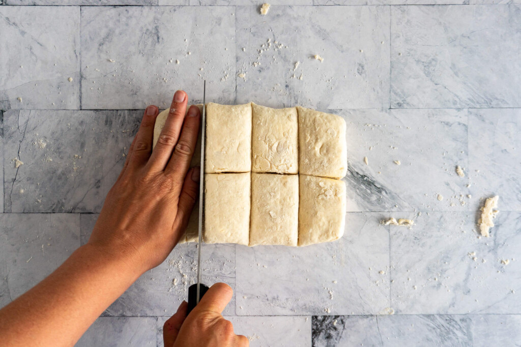Cutting the dough into even pieces.