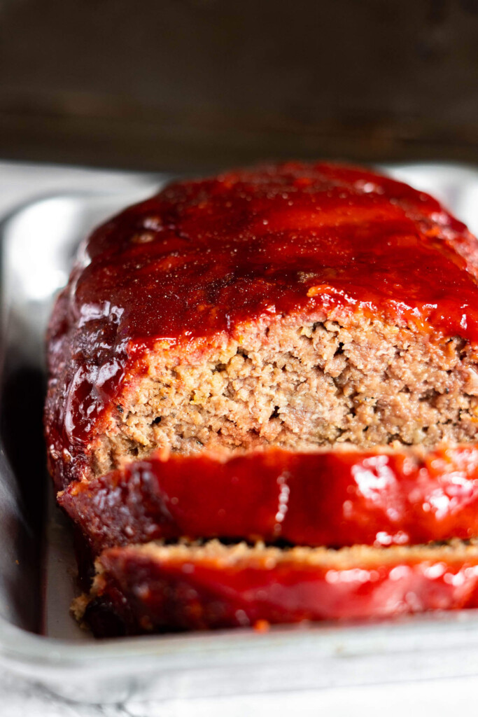 Smoked meatloaf on a small baking sheet.
