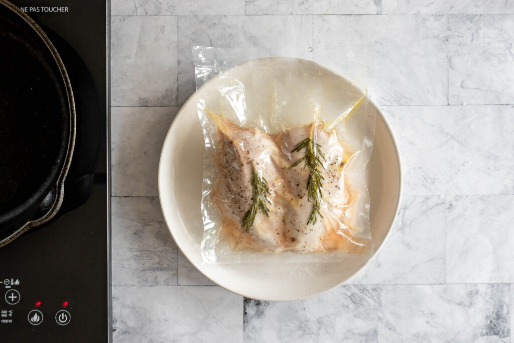 Cooked chicken breast in a sealed bag.