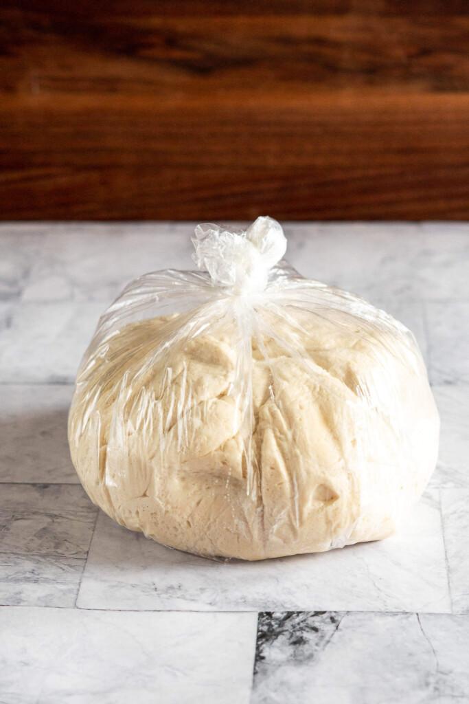 Pizza dough in a plastic bag.