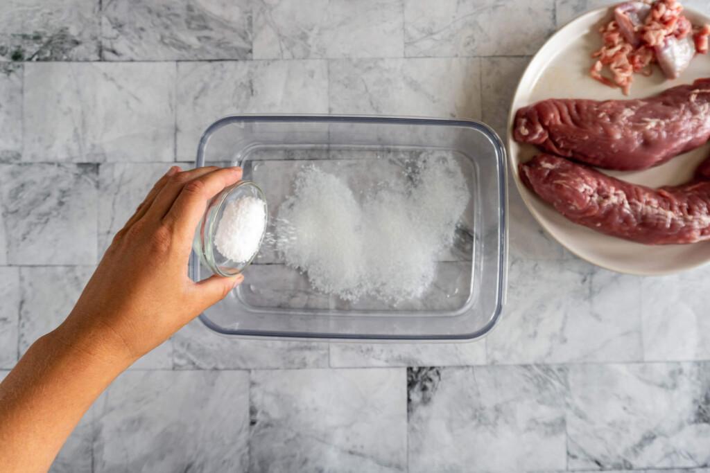 Adding the kosher salt to the brine.