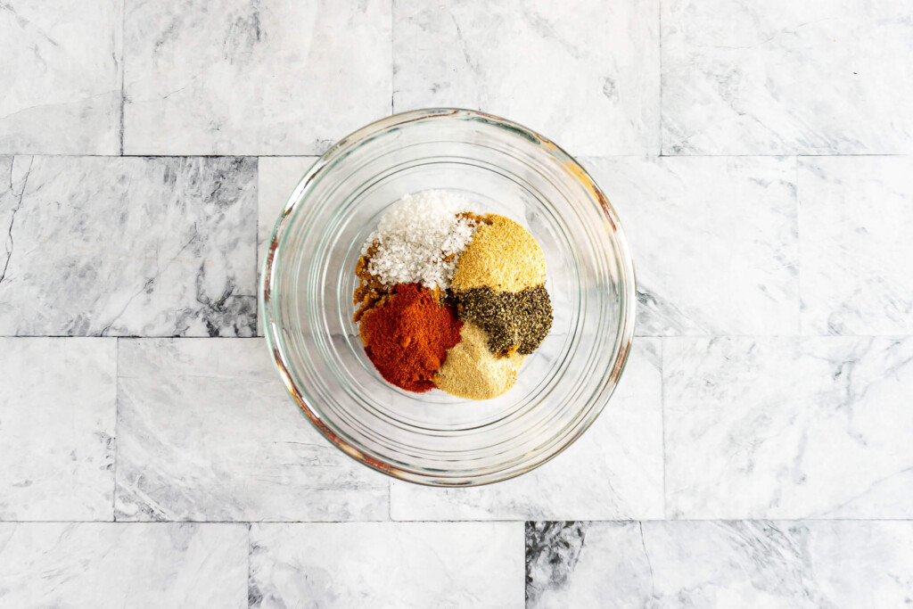 Ingredients for dry rub in a glass bowl.